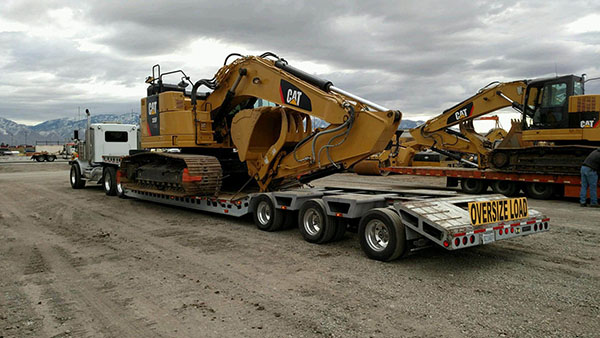 Tractor being Transported, heavy hauling tractor, tractor shipping quotes